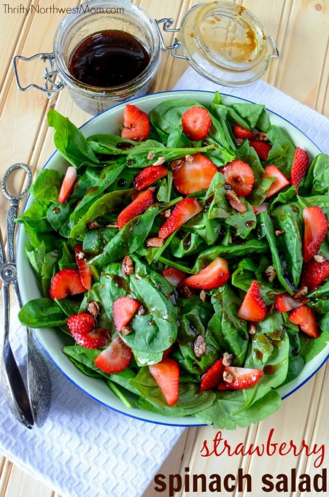 Strawberry Spinach salad is an easy & frugal summertime salad, perfect to bring to a picnic or 4th of July as an easy side dish.