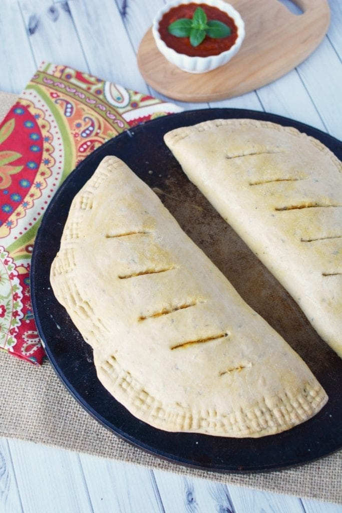 Calzones are a hearty, filling, freezer friendly meal for busy mealtimes