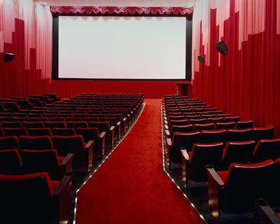 Movie Theater Coupons: $2 Hot Dog at Regal & Free Drink at AMC