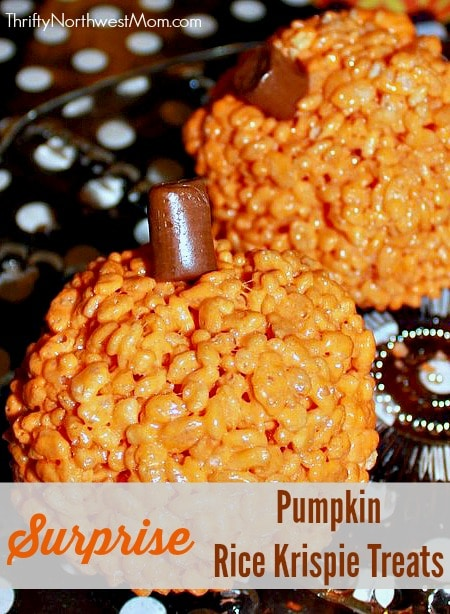 pumpkin rice krispie treats with a surprise perfect for halloween parties