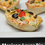 Mexican Layered Dip in Tortilla Bowls for Game Day Snack!