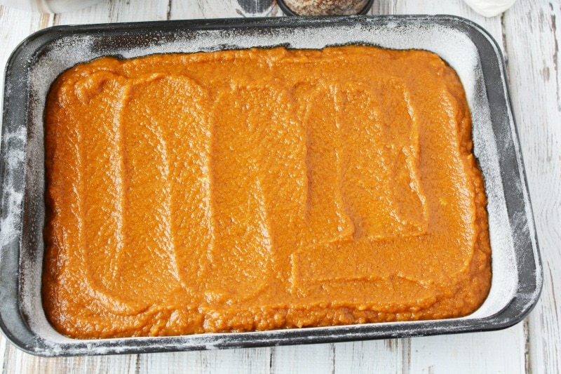 Spreading out Pumpkin Surprise to bake