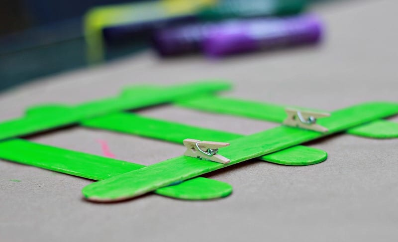 Adding mini clothespins to Fathers Day Frame