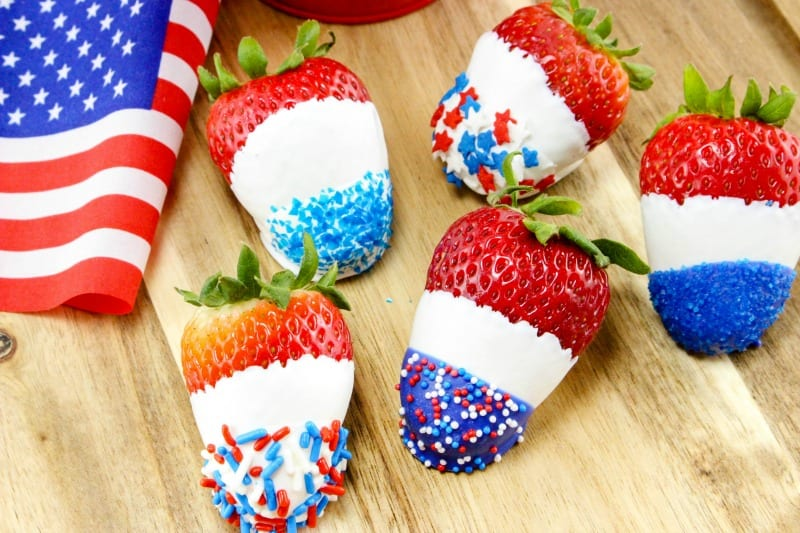 Patriotic White Chocolate Covered Strawberries are sure to be a hit at any 4th of July party