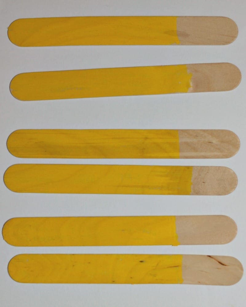 Popsicle sticks painted yellow