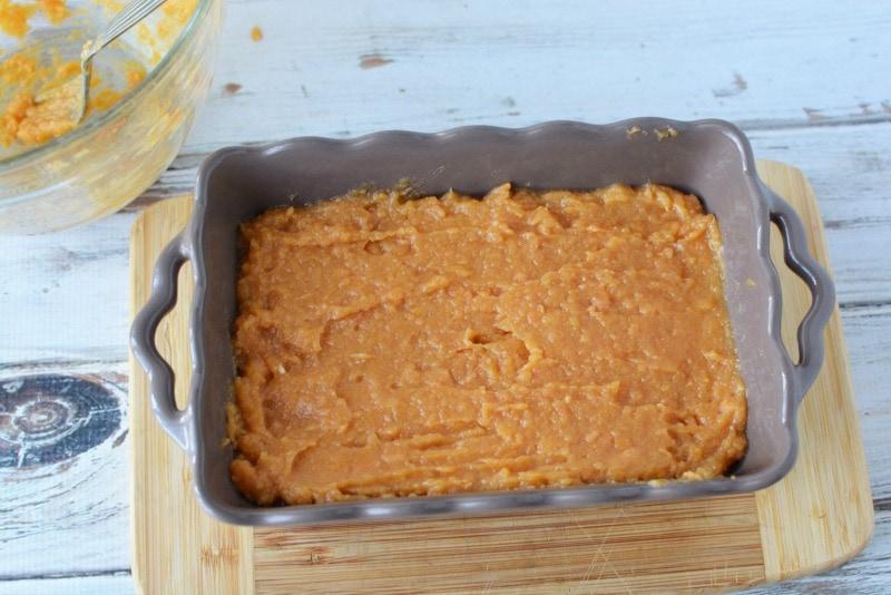 Putting sweet potato mixture into baking dish