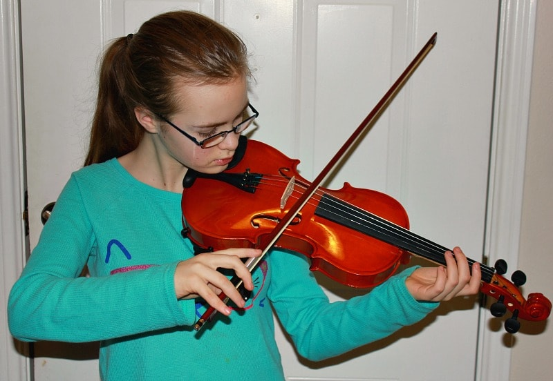 Trying out violin from ShopGoodwill.com site