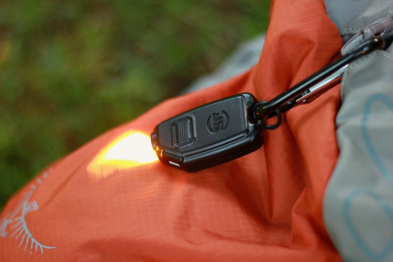 Surefire Sidekick Keychain Light attached to a carabiner for easy backpack access