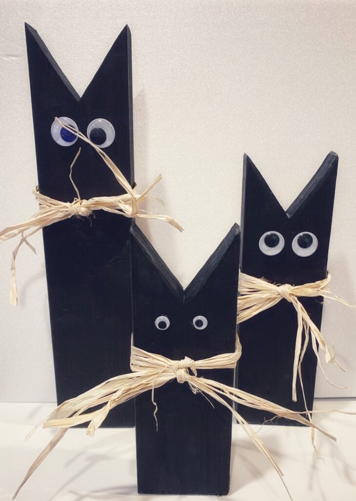 Black cats made from 2 x 4 wood pieces
