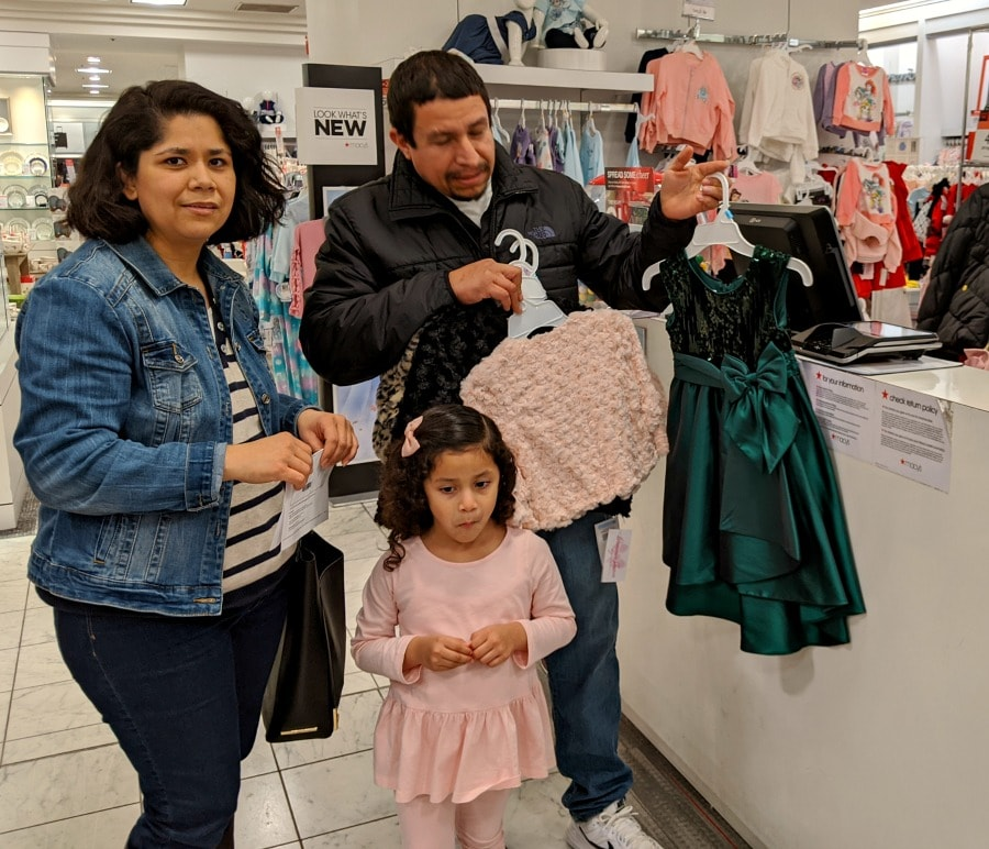Family Purchasing Items at Macys