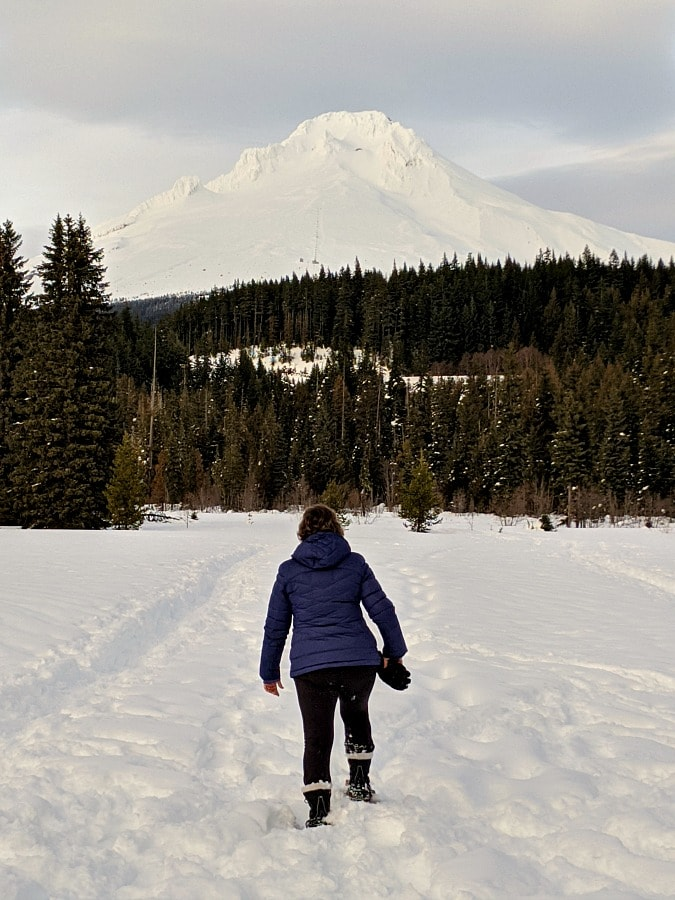 Snowshoeing at Trillium Lake with Mt Hood in distance