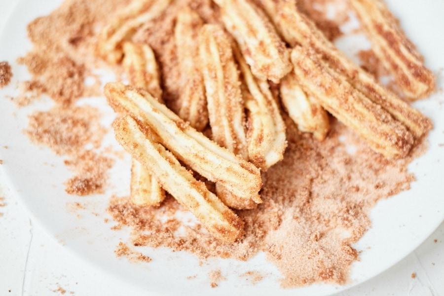 Coat churros with cinnamon & sugar