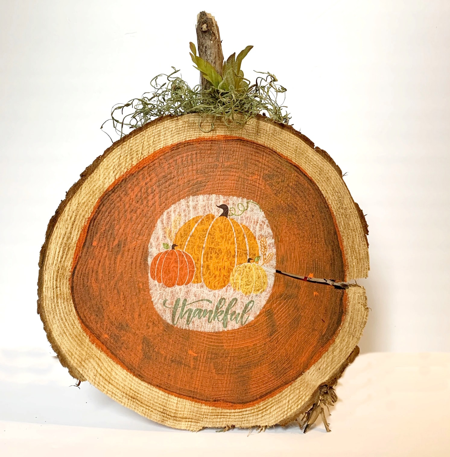 Decoupage napkins on wood pumpkins