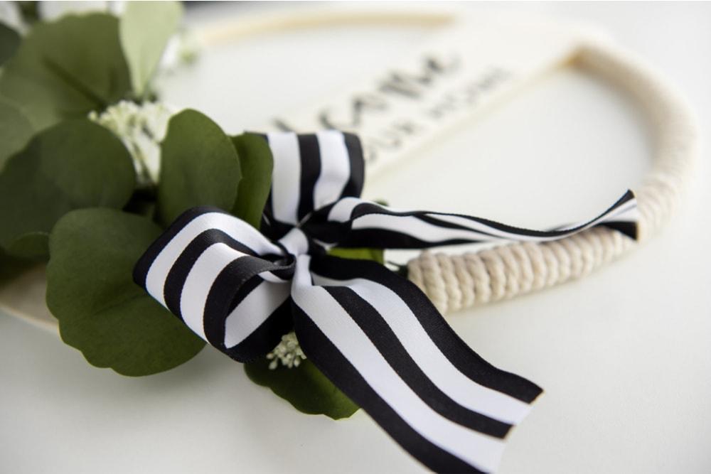 Add ribbon to wreath