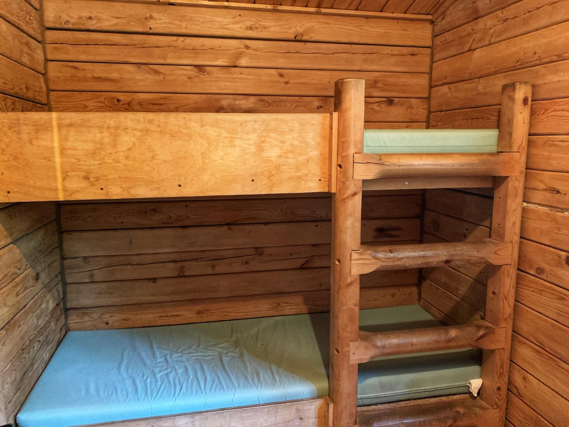 bunk beds in rustic cabin